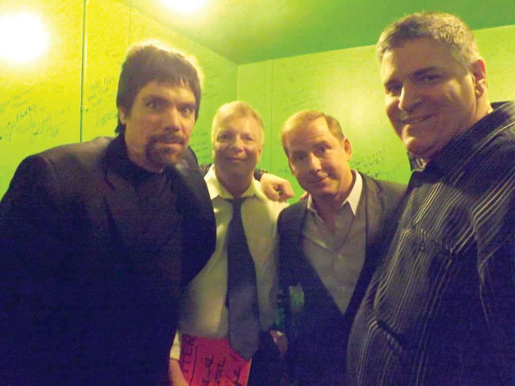 "MEMBERS ONLY: From left, ""Rockin'"" Joe Hebert, founder of the RICHOF, and its three members, Charlie Hall, Tom Cotter and John Perrotta, gather in the green room before Cotter's induction on April 4."