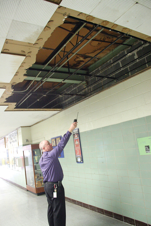 NO QUESTION WHERE IT LEAKS: Vets Principal Gerald Habershaw points to one of several areas of severe leaking in the school. The insert is of roof supports that are rusted and the supporting wall that is cracked.