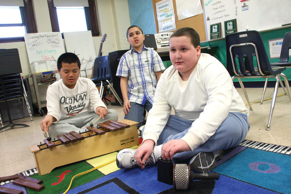 STORY WITH MUSIC: Using musical instruments to accentuate the story of a pair of white shoes are (from left) Julian Rhaney, Jayden DeBarros and Joe Rosati.