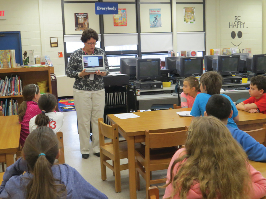 TECHNOLOGY TRAINING: On Friday morning, Warwick Schools' technology applications assessment coordinator Denise Bilodeau showed off the new Google Chromebooks to the students in Ann-Marie Scotti's fourth grade class. The new laptops will be used for online standardized testing and research projects in the classroom.