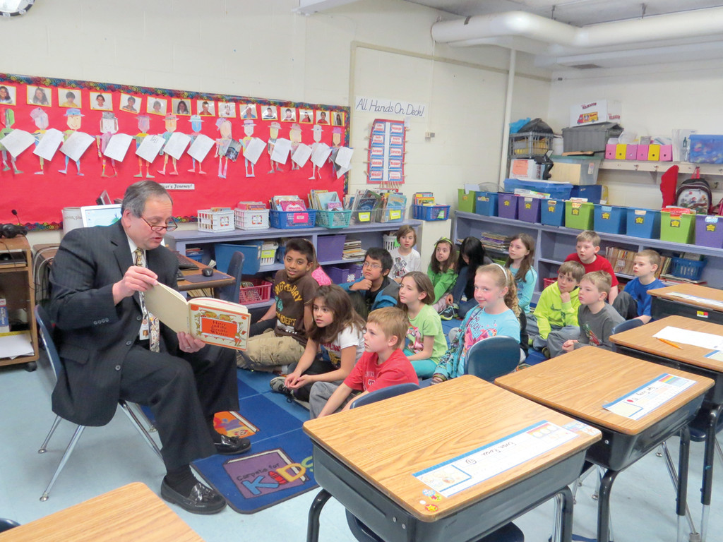 "READY TO READ: To celebrate Reading Week at Cedar Hills Elementary School, Superintendent Dr. Richard D'Agostino stopped by Dr. Laura Falvey's third grade class on Thursday to read ""Harry and The Terrible Whatzit"" by Dick Gakenbach, which told the story of a young boy's battle with the monster in the basement."