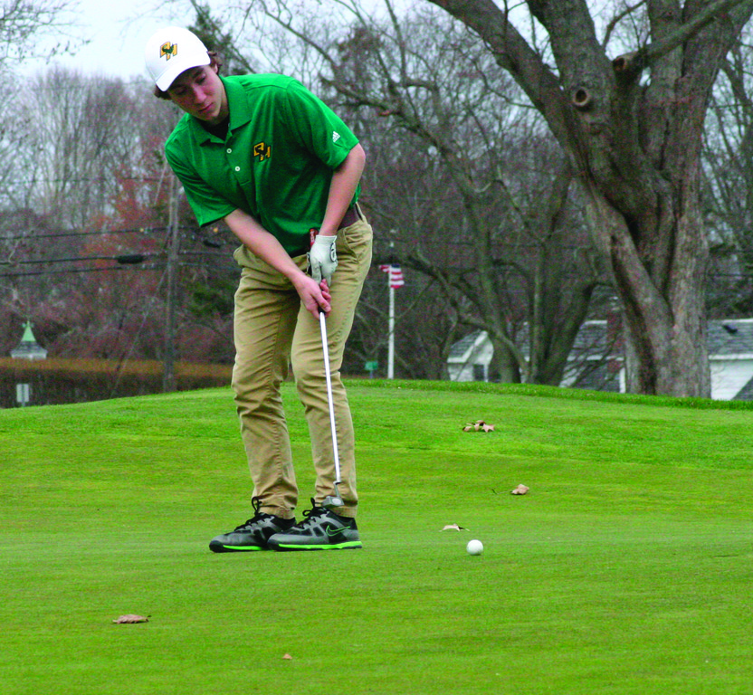 Hendricken�s Zach White watches his putt trickle toward the hole on Monday.