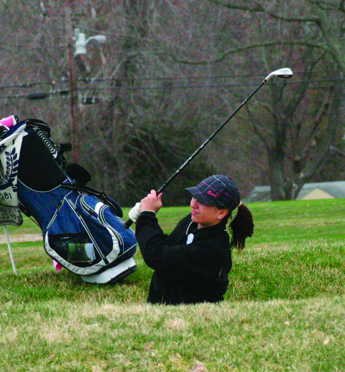 WATCHING: Pilgrim�s Jaycene Chattelle follows through on a shot from a bunker in Monday�s season-opening match.