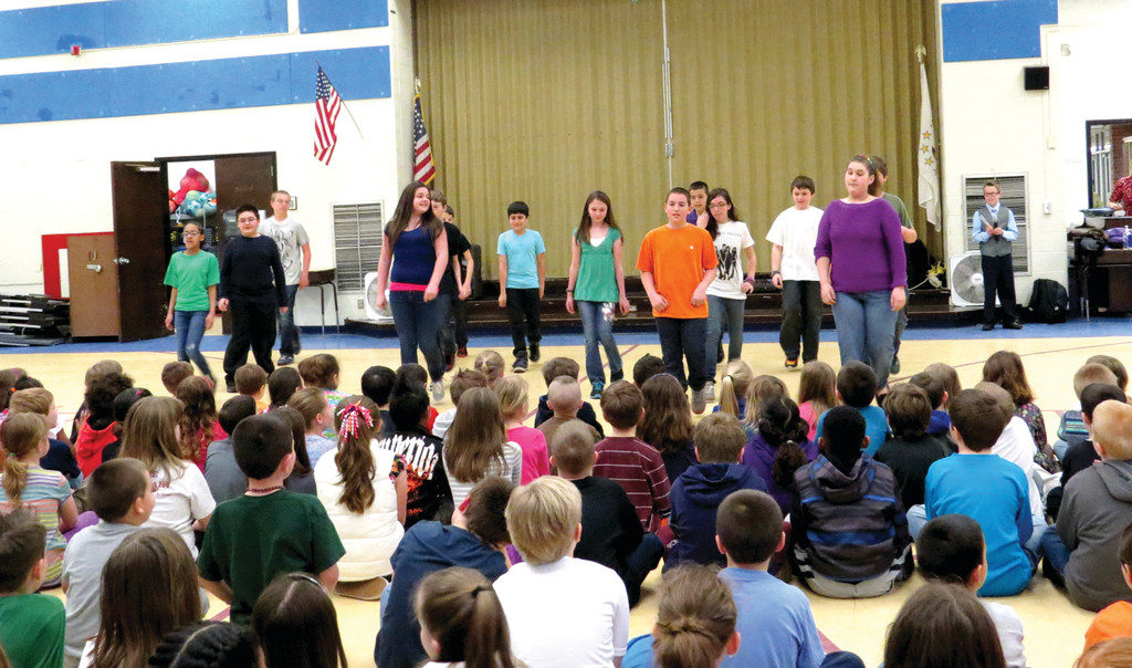In addition to her performance, Houle taught a small group of sixth graders to perform a short cha-cha for the younger students.