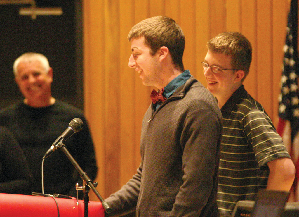 MOMENTS TO CHERISH: Tom Campbell and his brother Cole speak to the crowd at Thursday�s award presentation.