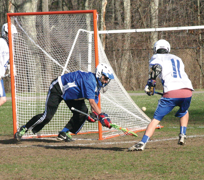 BETWEEN THE PIPES: Vets goalie Chris Defreitas keeps the ball out of the net during his team's 4-0 loss to Scituate.