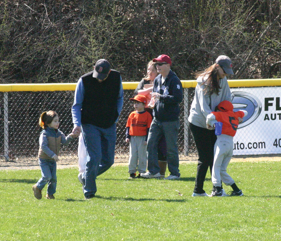 Parents and players gather in the outfield before the festivities.