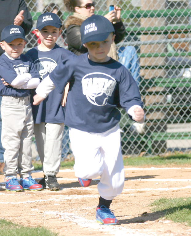 Braden Sawyer takes off in a tee ball race.