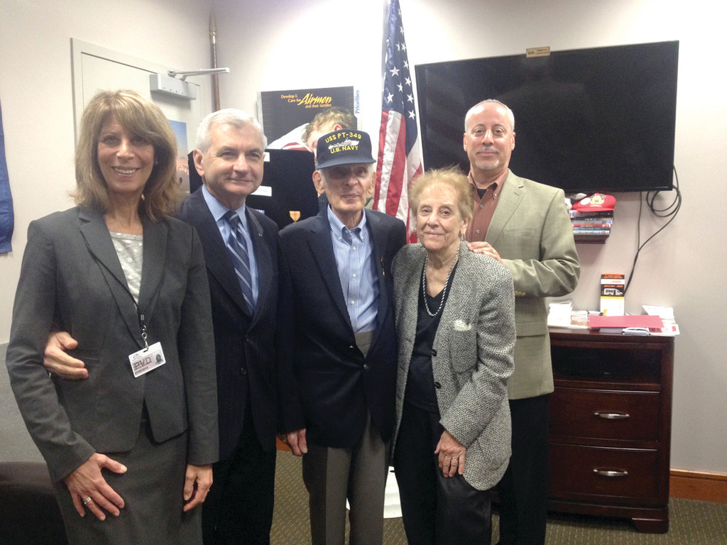 AT CEREMONY: From left: Mr. Poli's daughter Patti Goldstein, U.S. Senator Jack Reed, Mr. Poli, Mr. Poli's wife Angela, and Mr. Poli's son, also named Frank, pose for a photo after the medal ceremony at the T.F. Green Airport Military Lounge April 21.