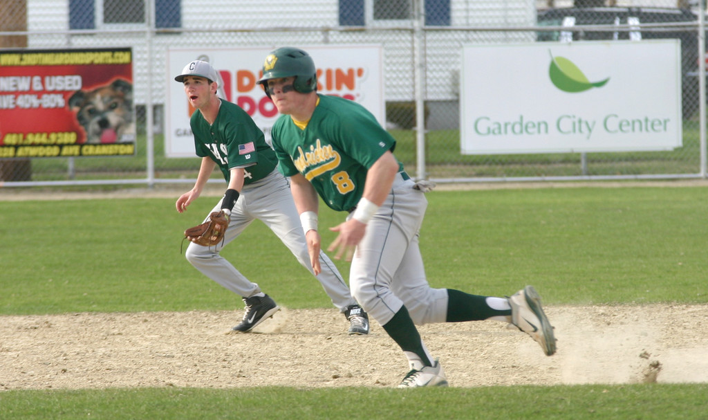 MOVING: Hendricken's John Toppa takes off from second base.