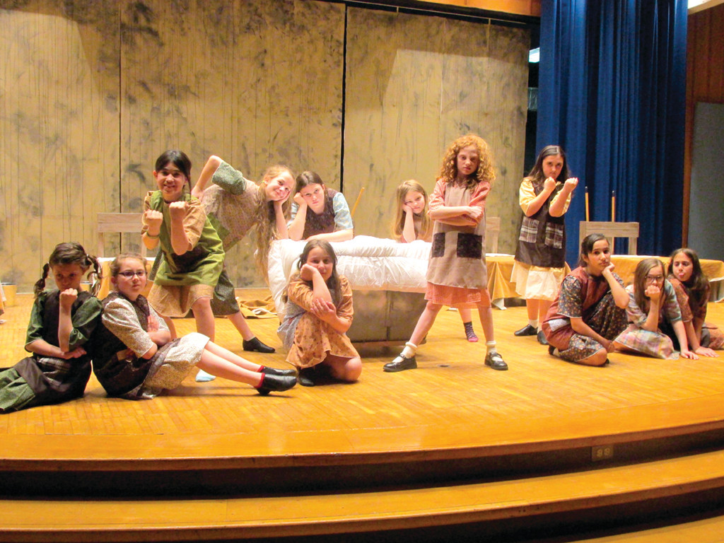 "VINTAGE LOOK: Dressed in garb dating back to the 1930s and the Great Depression, the youngsters who'll perform in J-DAPA's production of the musical ""Annie"" take their places on stage that resembles a municipal orphanage of yesteryear."