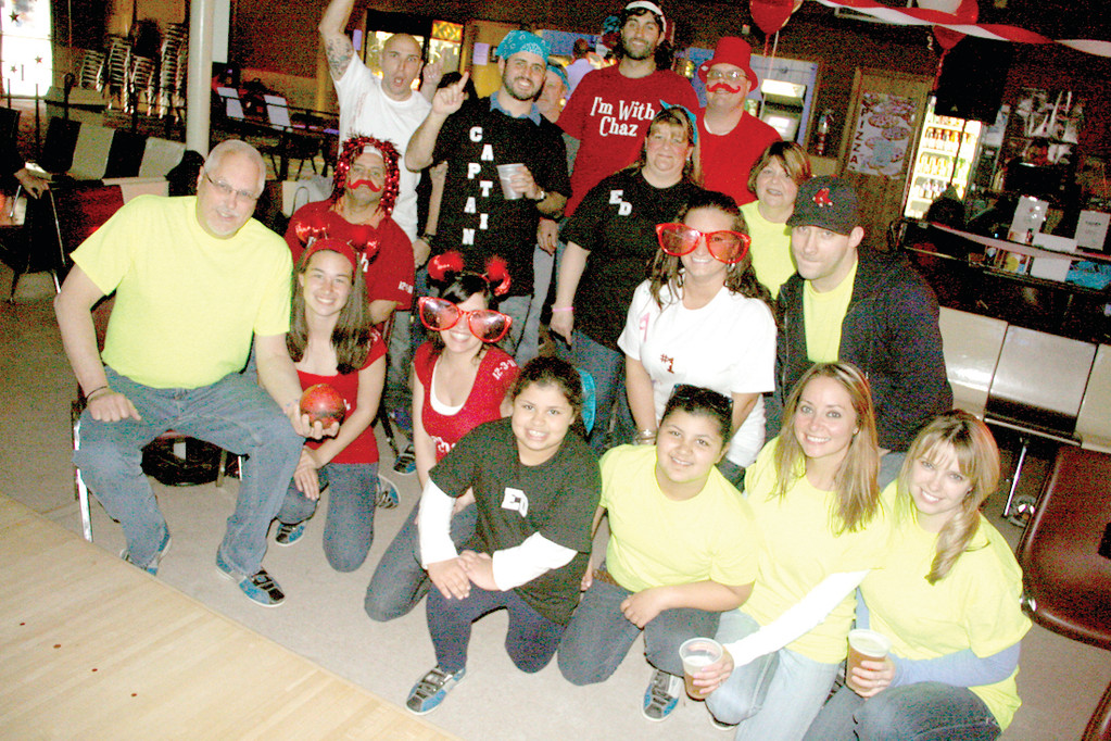 A BOWLING FAMILY: Ed Nievera, who is a wish grantor for Children's Wishes, brought friends and family with him for Sunday's fundraising bowling event at Meadowbrook Lanes.