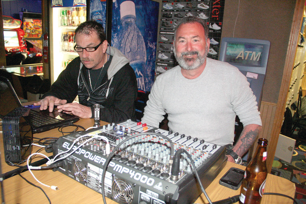 MUSIC MEN: Lou Geremia and Joseph Fordham volunteered their afternoon to work as DJ for the bowlers.