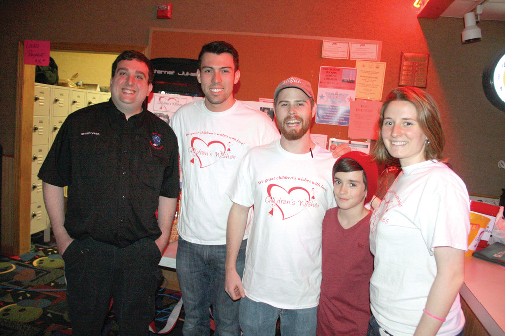 TEAMING UP FOR A CAUSE: Christopher Diaz (at left) had the help of PC students Mike Escribano, Pat Smith and Elizabeth Saville in staging the bowling fundraiser to benefit Children's Wishes. Tyler Shammas, also pictured, helped out.