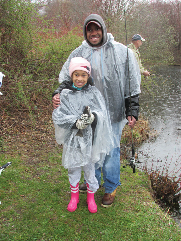 REASON TO SMILE: Jada Stackhouse, 8, holds one of several speckled trout she caught Saturday in the Tri-City Elks Kids Fishing Derby as her father, Tony Stackhouse, is all smiles.