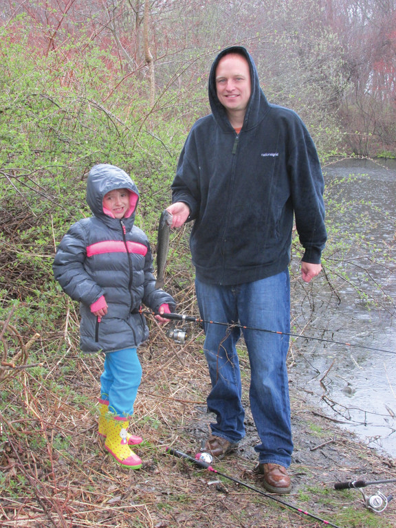 BIGGEST FISH: Although Maya O�Connell, 7, caught the biggest trout in Saturday�s Kids Fishing Derby, she gave the honor of holding the fish for this photo to her proud pop, William O'Connell. Her catch weighed one pound, one ounce.