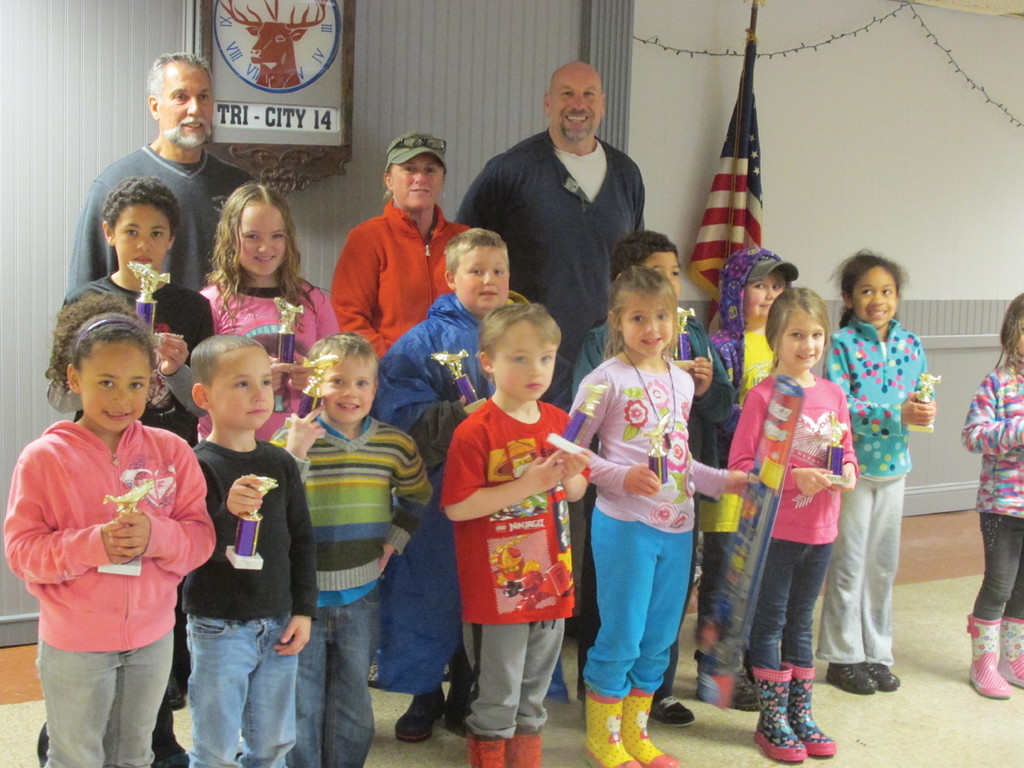 LOTS OF TROPHIES:  �This is what I love seeing,� Griff Williams (back right) said Saturday after presenting upwards of two dozen kids a special trophy for their participating in the sixth annual Kids Fishing Derby at Elks Lodge No. 14 in Warwick. Also in back is Mark Eaton, the Exalted Ruler.