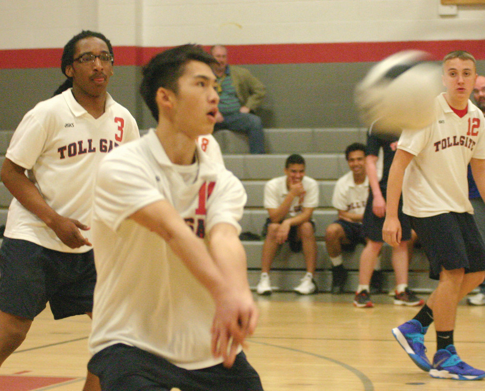 IN POSITION: Wendell Thao receives a serve in Friday's match.