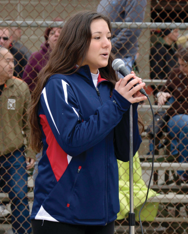 Samantha Hopgood performs the National Anthem.
