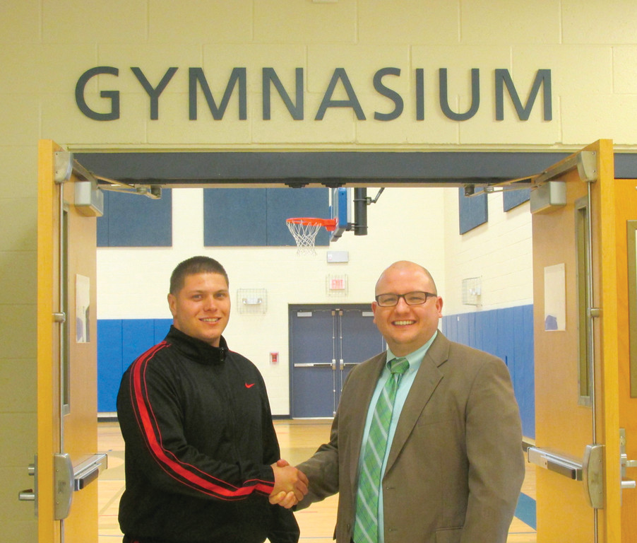 "WELCOME ABOARD: Former Johnston High Athletic Director David A. DelFino, left, gets a ""welcome aboard"" handshake from Brian Cordeiro, the principal at Immaculate Conception Regional Catholic School in Cranston, where he'll be a physical education/health teacher and coach."