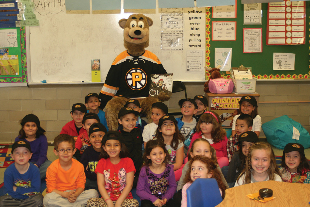 "ALL TOGETHER NOW: Stephanie Blais' students pose for a whole-class shot with Providence Bruins mascot Zambone and his friend Blair Carroll after they listened to the story ""Otis."""