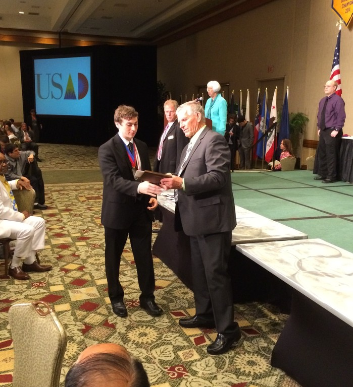 BIANCO MVP: Bishop Hendricken senior and Warwick resident Chris Bianco receives his Most Valuable Team Member award, as voted by his teammates, at the 2014 United States Academic Decathlon National Finals, held April 24-26 in Honolulu, Hawaii. Bianco earned two of the Hawks' seven individual medals, far and away the best performance in Hendricken's five trips to the national competition.