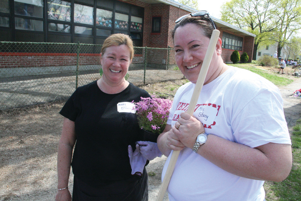 HORTICULTURE TIPS: Mary O'Toole, left, provided guidance for the greening of Greenwood that teacher Cheryl Stacy organized.