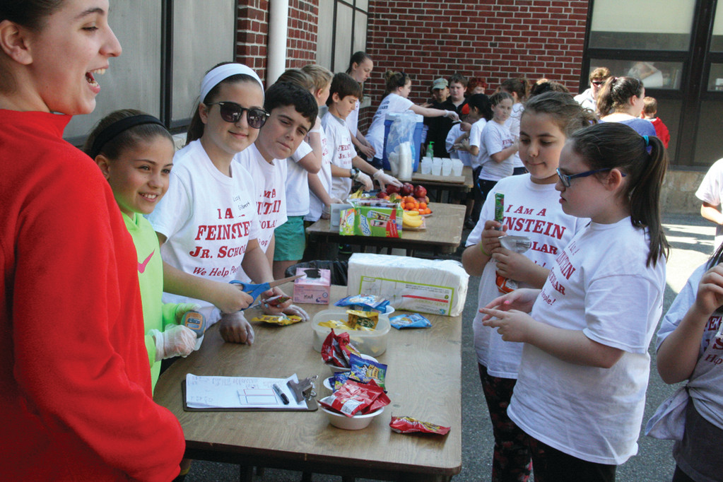 SNACK TIME: Students even manned the snack and beverage tables where students quickly gravitated when given a break from the cleanup.