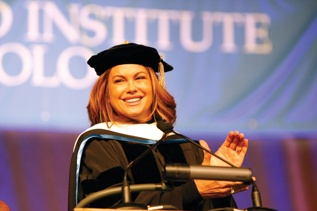 APPLAUDING THE GRADS: Kathy Ireland on stage at the NEIT commencement Saturday.