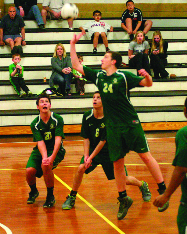 WHATEVER IT TAKES: Hendricken�s Dan Flaherty sends the ball over the net on Thursday.