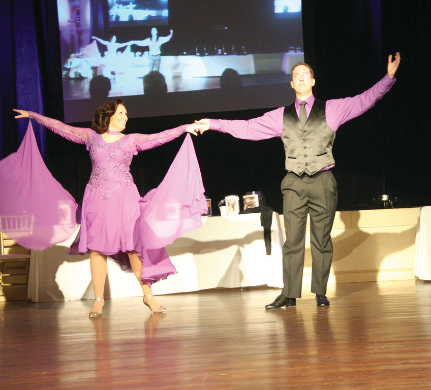WITH FLAIR: Professional dancer Deborah O�Donnell and her partner, Adam Konow, Amgen senior manager of quality control performed a beautiful paso doble.