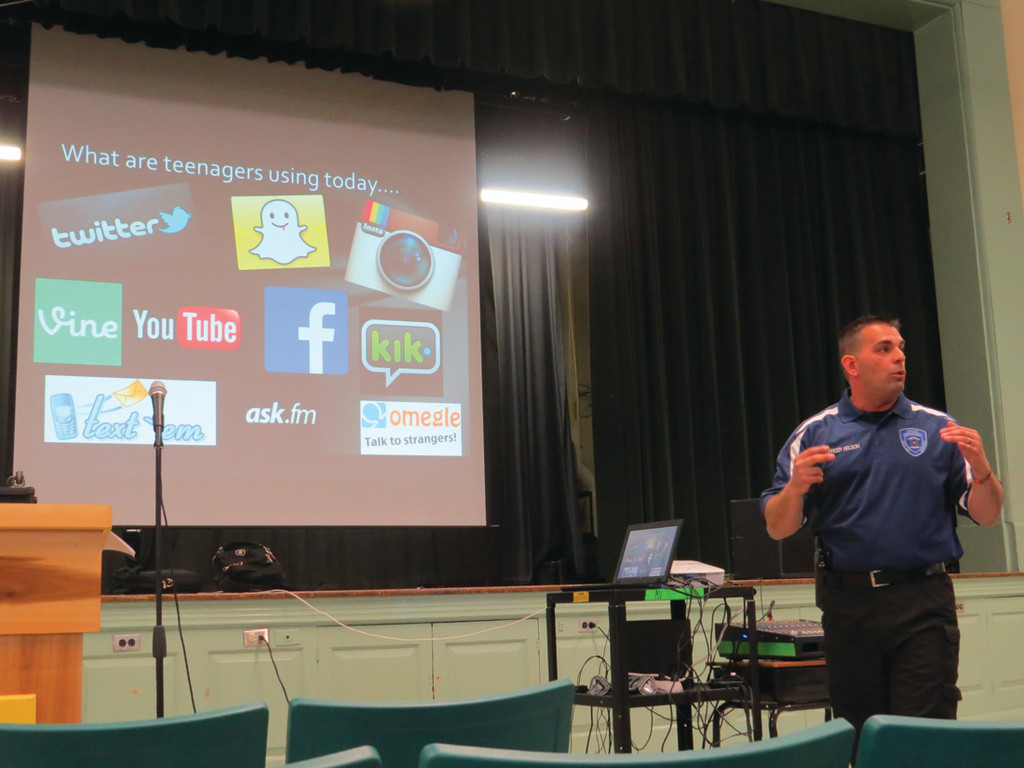 AN APP FOR ANYTHING: During Tuesday's Gorton PTA-sponsored Cyberbullying and Internet Safety presentation, Warwick junior high school resource officer Nelson Carreiro (along with Warwick Vets SRO Leo Tetrault, not pictured) highlighted a number of social media apps popular among Warwick students and provided parents with tips on how to make sure their kids are being safe online.