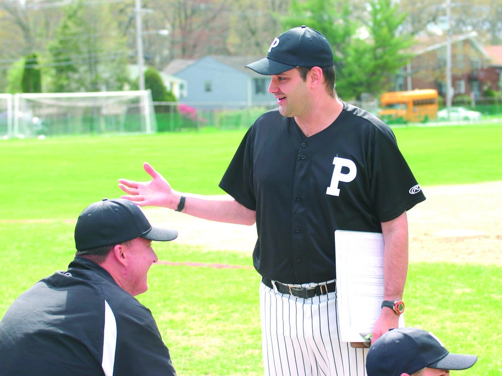 A WARWICK INSTITUTION: Brian Tucker chats with Pilgrim players and coaches before Tuesday's game against North Kingstown.