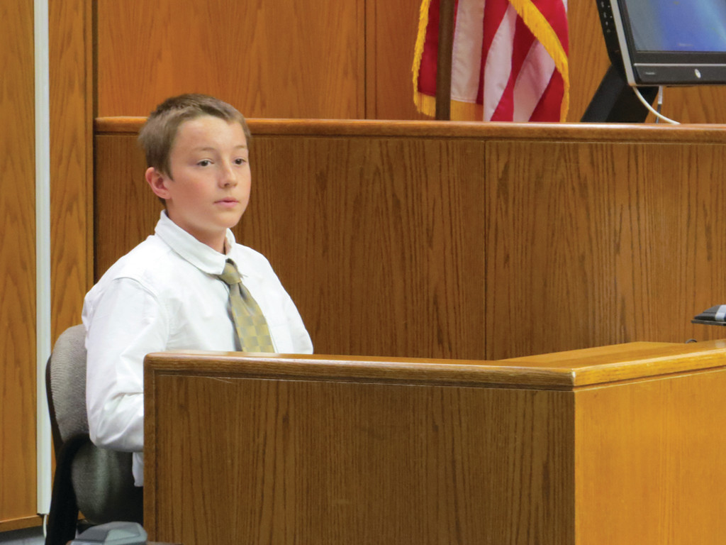 QUESTIONING THE WITNESS: Winman Junior High student Axel Olsson remains calm in the witness box, portraying the plaintiff's best friend and a witness to the shooting.