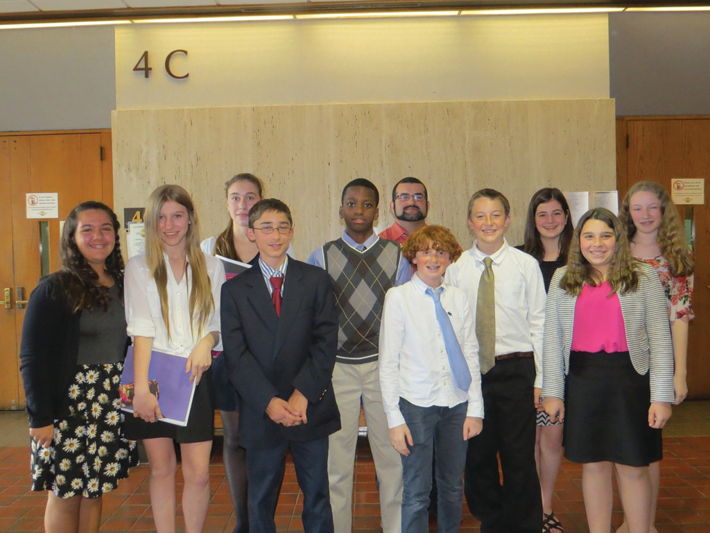 FUTURE LAWYERS: The Winman Junior High Mock Trial team won their case, and the first-ever Junior Division State Mock Trial Championship, on Tuesday with fantastic performances from Bella Bianco, Sophia Maynard, Grace Reed, Alex Sinapi, Joel Roache, Coach Anibal Raposo, Ben Rosenberg, Axel Osson, Rebecca Carcieri, Maddy Cuddy and Lauren Campbell.