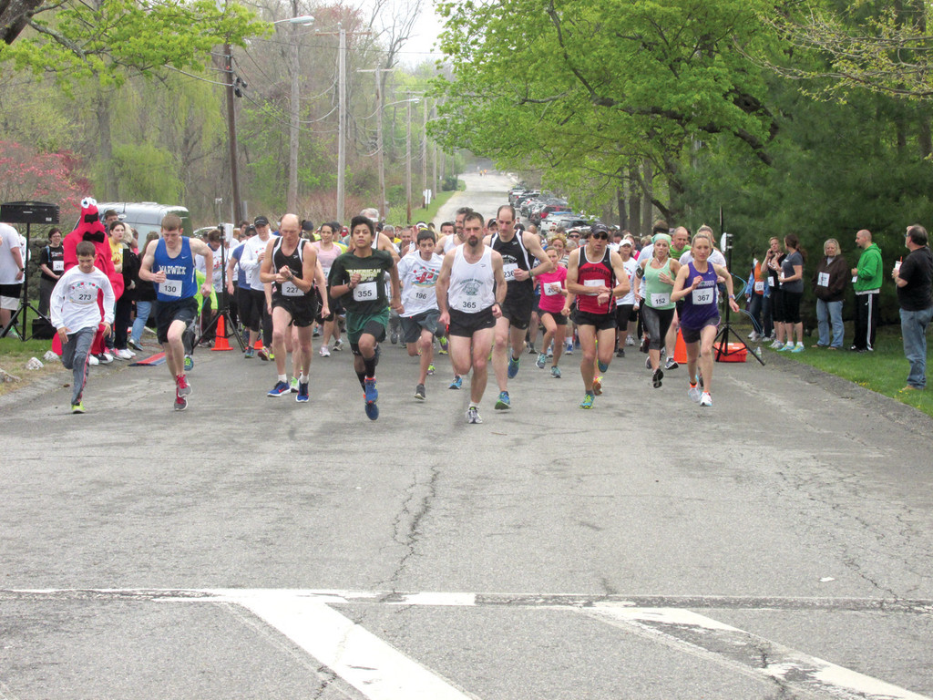 "THEY'RE OFF: This is the start of Saturday's second annual Rocky Point 5K Road Race that began with the traditional ""uphill trek"" that took runners up Rocky Point Avenue and onto Warwick Neck Avenue."
