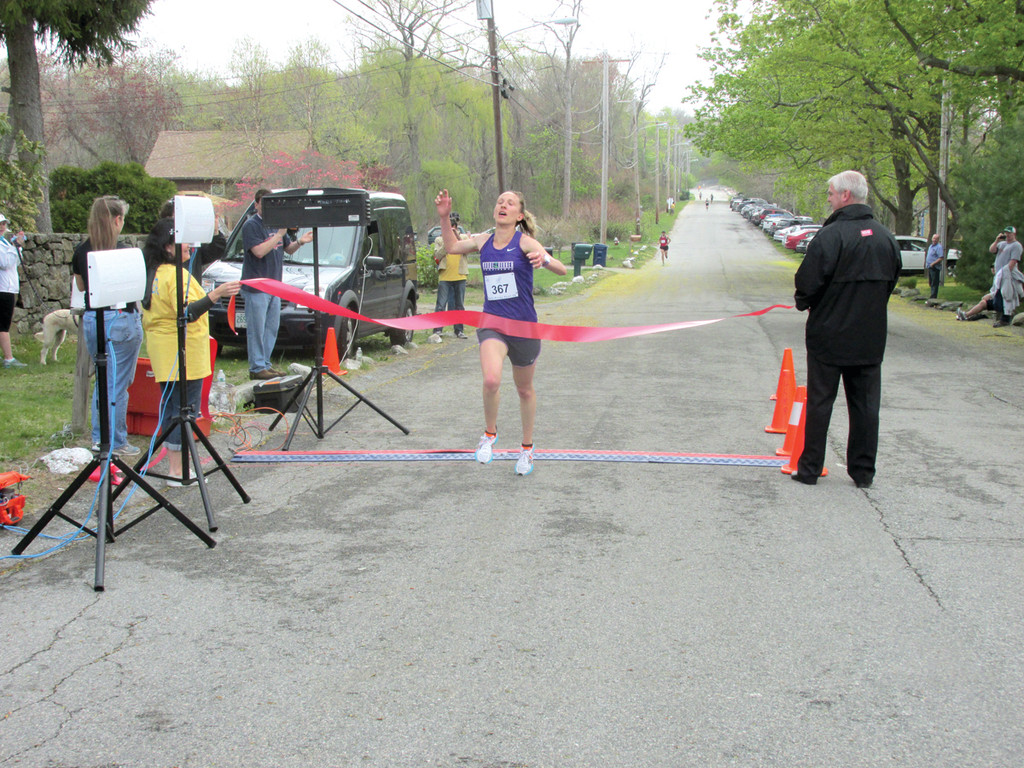 HAMP'S CHARGE: Katie Moulton, 31, a track and field coach at Chariho High School who lives in Providence, surges across the finish line on Warwick Neck Avenue, winning the second annual Rocky Pint 5K Road Race in 17 minutes and 51.1 seconds.