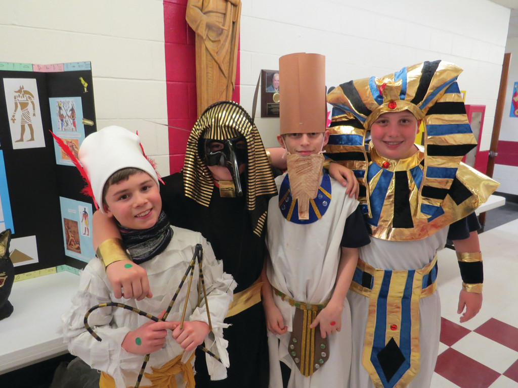 CAST OF CHARACTERS: Classmates Jacob Morse, Austin Noon, William Walaska and Ashton Allcock welcomed guests to the Egyptian Museum as the first exhibits to see, portraying Osiris, Set, Mentuhotep II and King Tut, respectively.