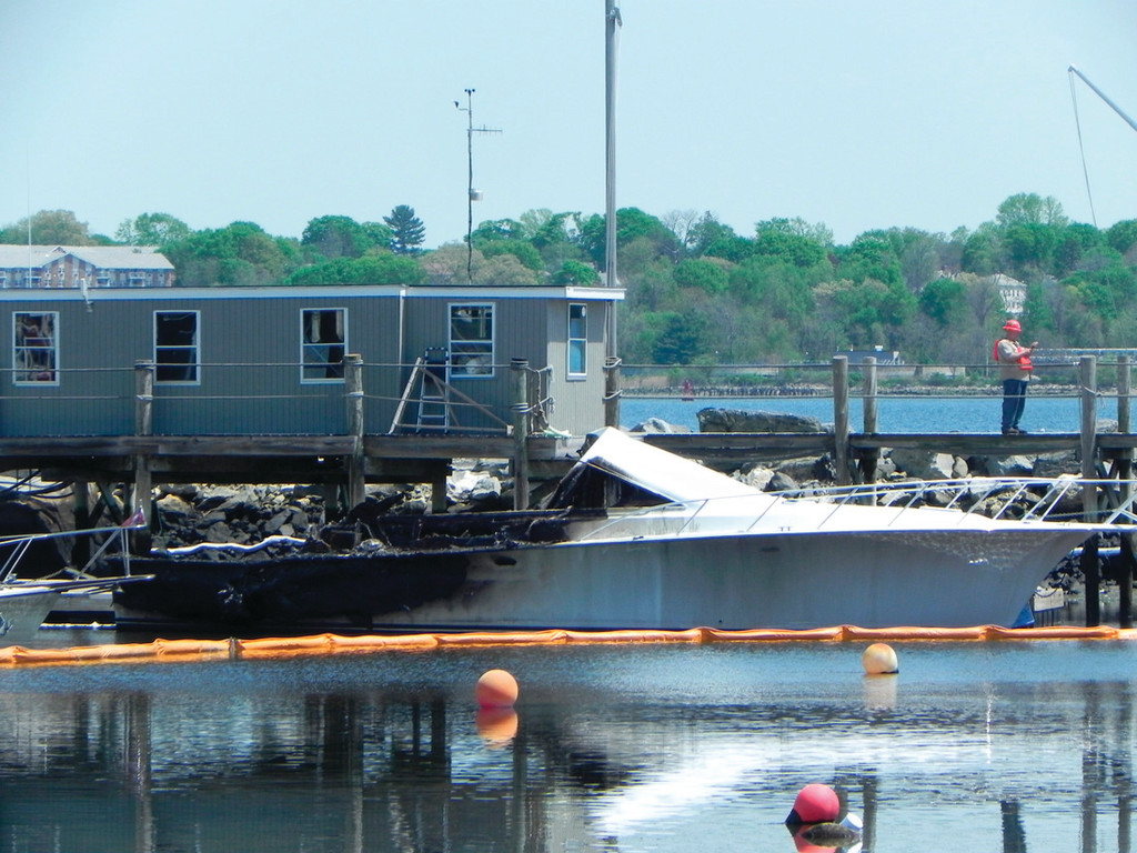PROBE CONTINUES: One of the fire-ravaged boats. The  investigation of the fire at the  yacht club continues.
