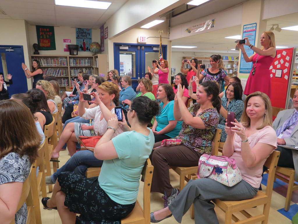 CAMERA-READY MOMS: The moms in the audience at Warwick Neck's Mother's Day Tea had their cameras and camera phones ready to capture their children's musical performance and special tribute videos yesterday.