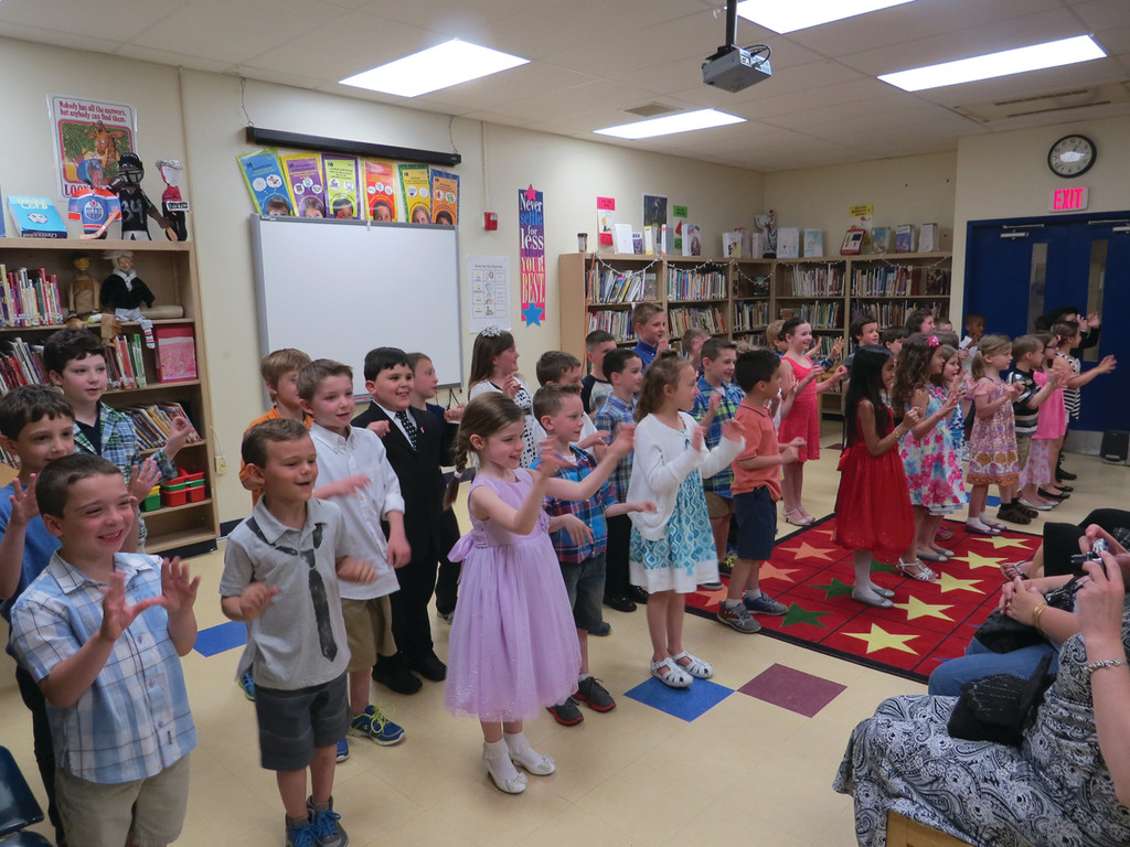 "STARTING OFF WITH A SONG: Warwick Neck Elementary first-graders kicked off their Mother's Day Tea with a special performance of the song ""Happy"" and another mom-themed number. Then the audience got to watch special tribute videos each student made using their computer coding skills for their mom for Mother's Day."