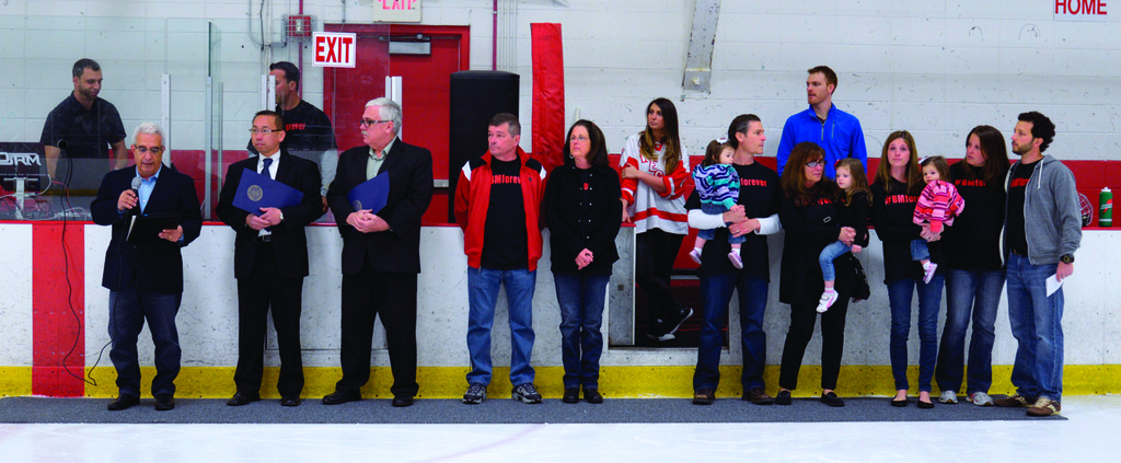 Mayor Allan Fung stands with the Moretti family during a pre-game ceremony.