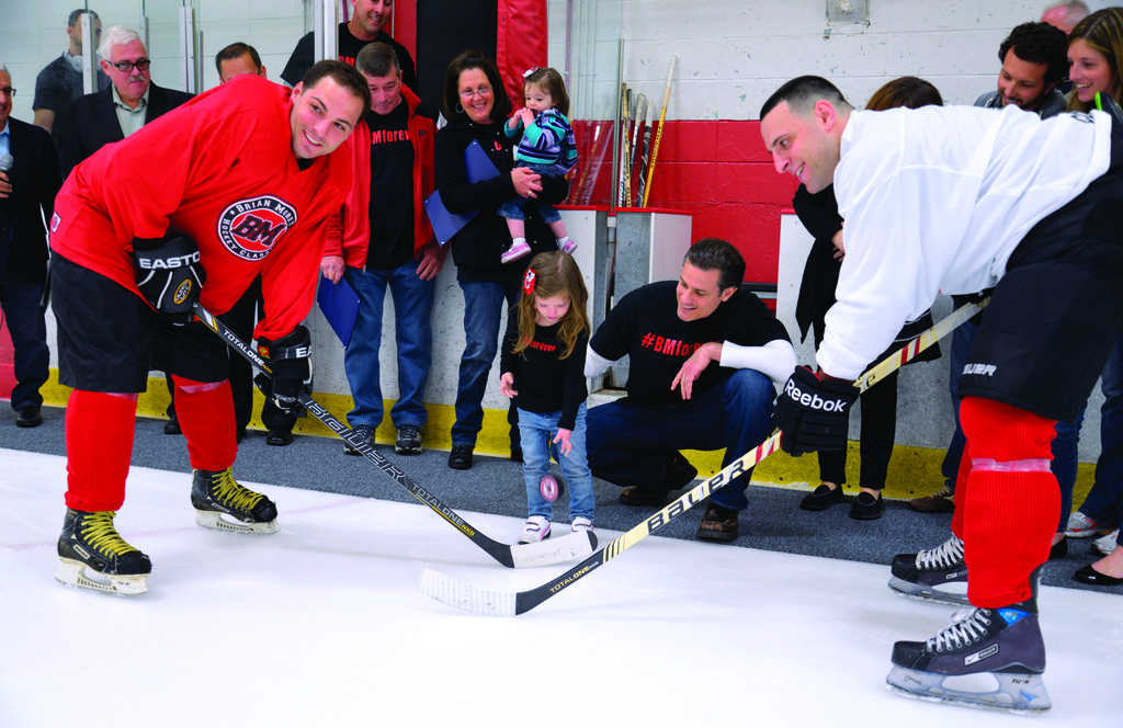 Addison Grace drops the puck between James Tomaselli and Matt Brannon.