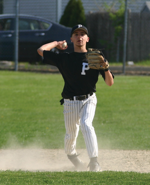 REAR BACK: Tyler Perry throws the ball across the diamond in a 2-0 loss to South Kingstown on Friday.
