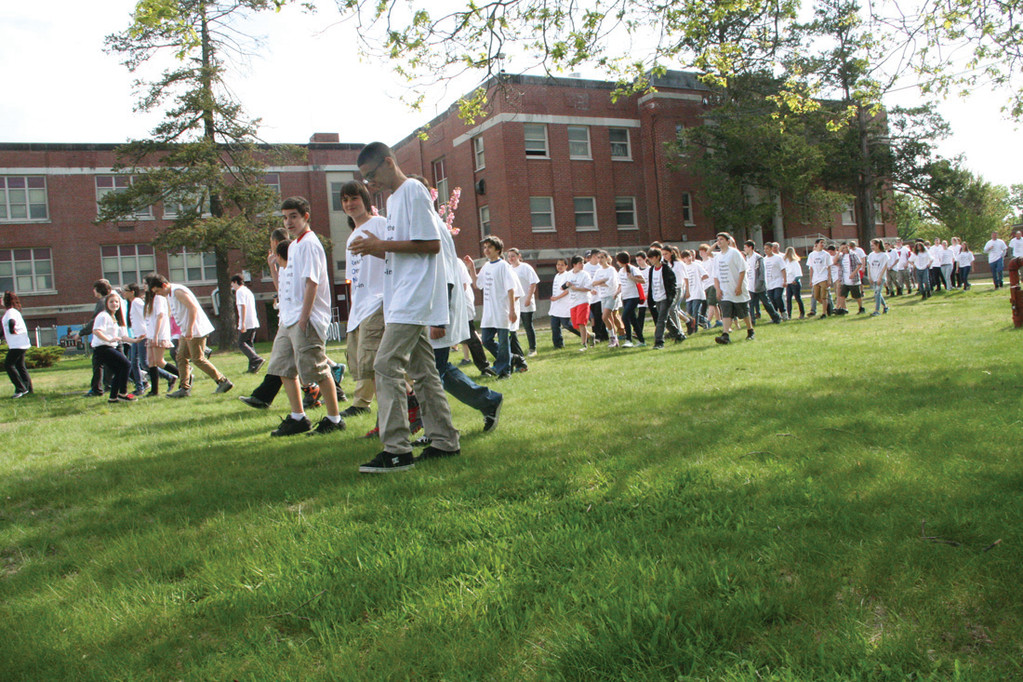 TIME OUT: Gorton students and faculty begin their trek, marching past the school building.