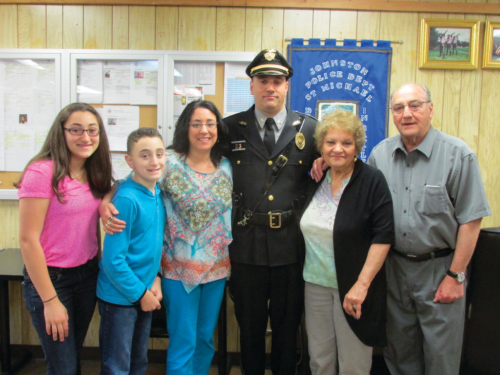 TO PROTECT AND SERVE: Johnston Police Sgt. Luca Lancellotti is joined by his daughter Bianco, son Vincent, wife Denise and parents Luca and Sandra Lancellotti after being sworn in and promoted from the rank of patrolman Monday.