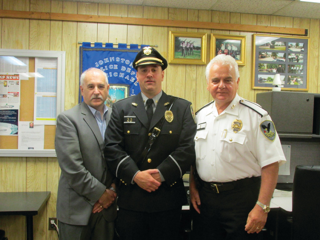 NEW SERGEANT: The Johnston Police Department�s newest sergeant, Luca Lancellotti, is joined by Mayor Joseph Polisena and Chief Richard S. Tamburini following a special promotion ceremony Monday at Johnston headquarters.