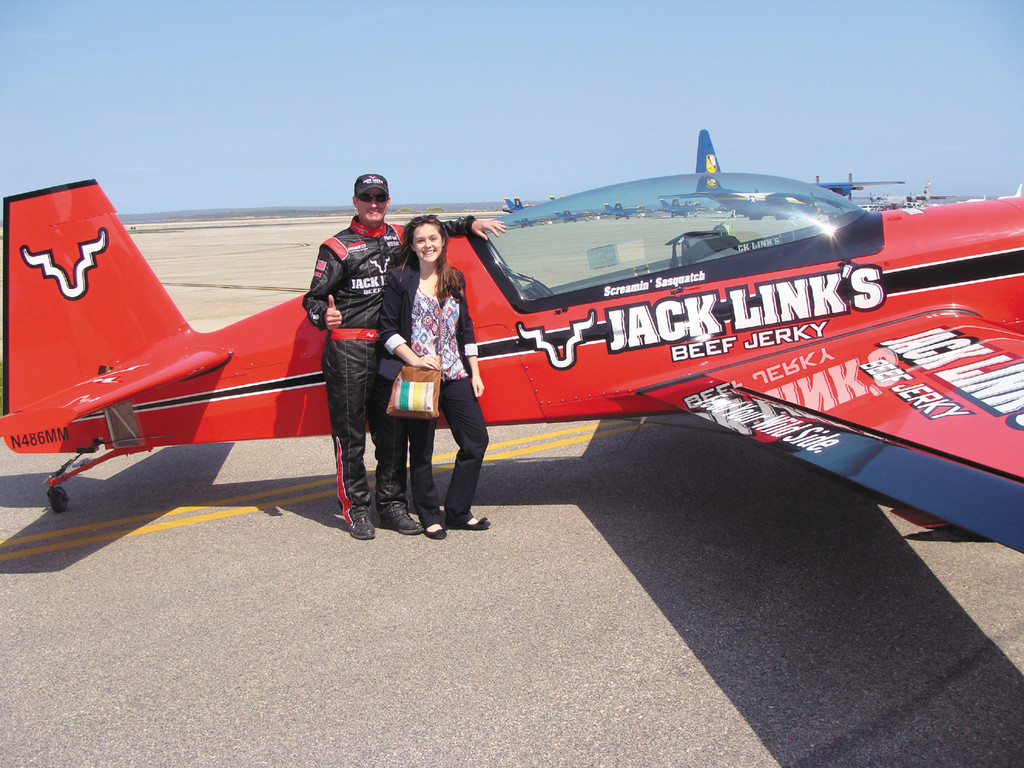 ready to fly: Kelcy Dolan stands with Jeff Boerboon prior to her experience flying in the Jack Link's Extra 300 L at the air show this past weekend.