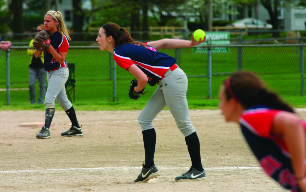 WOUND UP: Toll Gate�s Courtney Marsh gets set to deliver a pitch during Thursday�s 1-0 win over Barrington. Marsh took a perfect game into the fifth.