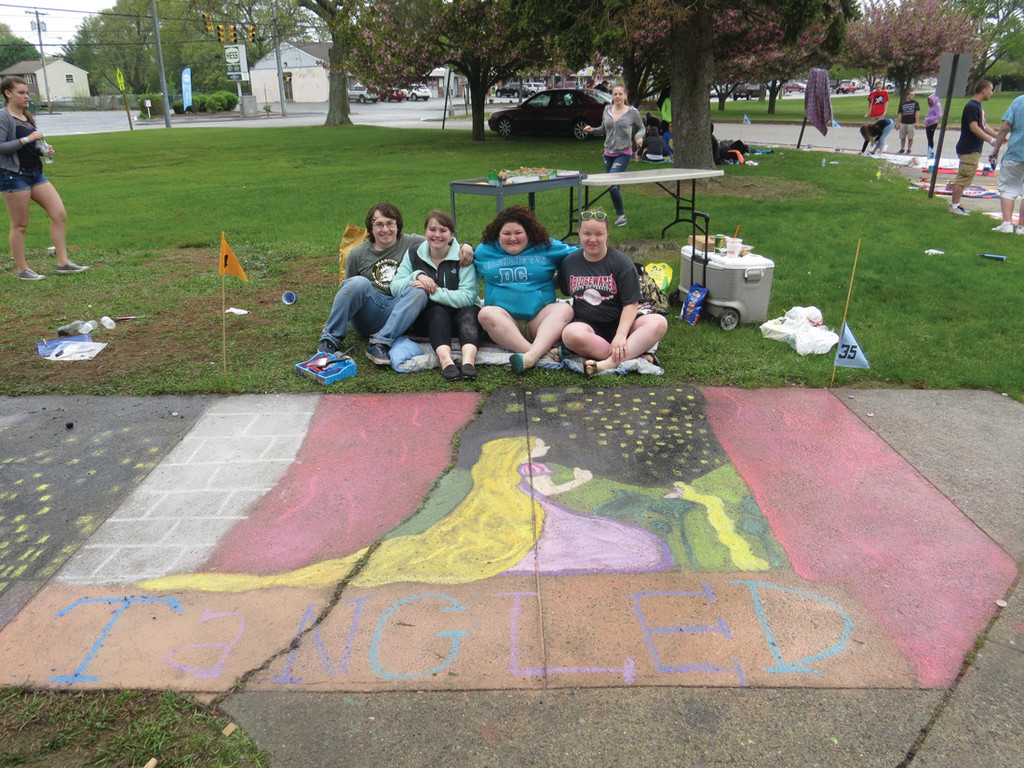 RAINING ON THE ART PARADE: Despite the wet weather, seniors from Warwick Veterans Memorial High School still had a fun, relaxing day together for the 11th annual Sidewalk Chalk Art project. To save their work from the rain, many resorted to covering the completed potions with blankets and tarps.